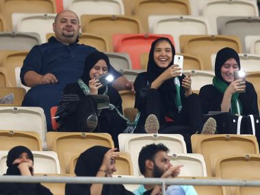 Female Saudi supporters of Al-Ahli attend their team's football match against Al-Batin in the Saudi Pro League at the King Abdullah Sports City in Jeddah. AFP