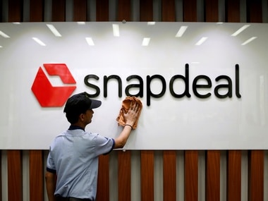 An employee cleans a Snapdeal logo at its headquarters in Gurugram. Image: Reuters