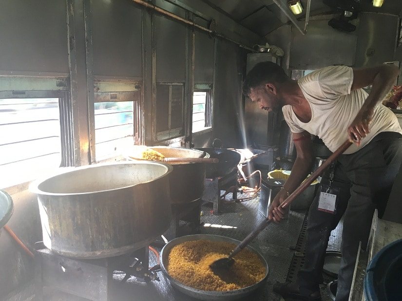 Suresh Prajapati, one of the maharaj's (cook) on board works on the day's dinner. - Copy