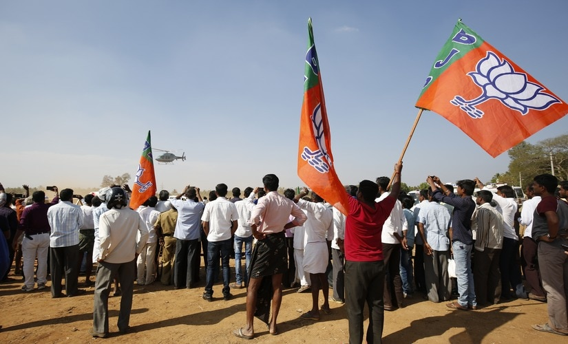 The crowd at the rally cheers for Amit Shah.
