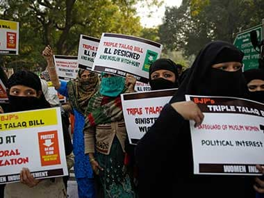 Muslim women and members of Women India Movement hold placards as they march against the triple talaq bill. AP