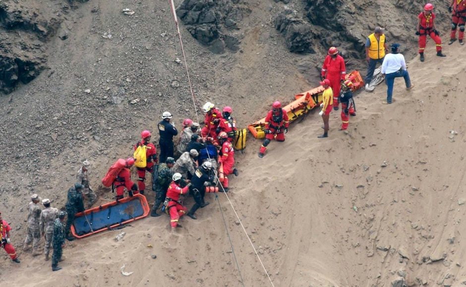 Firefighters and police worked for more than 24 hours to recover the remains, tying bodies onto stretchers and pulling them up the cliff with ropes. AP