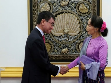Myanmar's State Counselor and Foreign Minister Aung San Suu Kyi, right, shakes hands with Japanese Foreign Minister Taro Kono after their joint press conference at the Ministry of Foreign Affairs in Naypyitaw, Myanmar Friday, Jan. 12, 2018