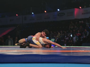 Veer Marathas Parveen Rana (Yellow) beats Mumbai Maharathis Praveen Dahiya (white) by 6-4 on day 9 of the 3rd Pro Wrestling League being held at Siri Fort Stadium in New Delhi.