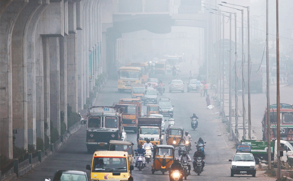 Commuters ride through a street on a cold and foggy morning in Hyderabad. Fog engulfed many parts of the country, disrupting normal life and throwing rail and road traffic out of gear. AP