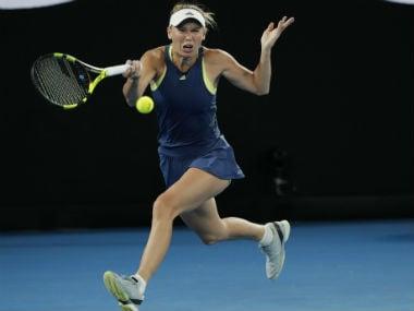 Caroline Wozniacki in action against Carla Suarez Navarro. AP