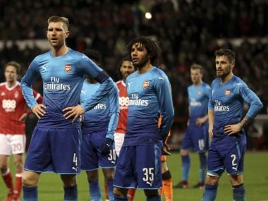 Arsenal's Per Mertesacker and Mohamed Elneny look dejected during the FA Cup match against Nottingham Forest. AP
