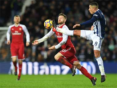 West Brom's Jake Livermore (R) vies with Arsenal's German defender Shkodran Mustafi during their Premier League match at The Hawthorns stadium. AFP