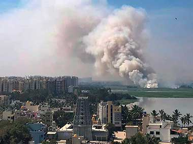 File image of a fire at Bellandur lake. PTI
