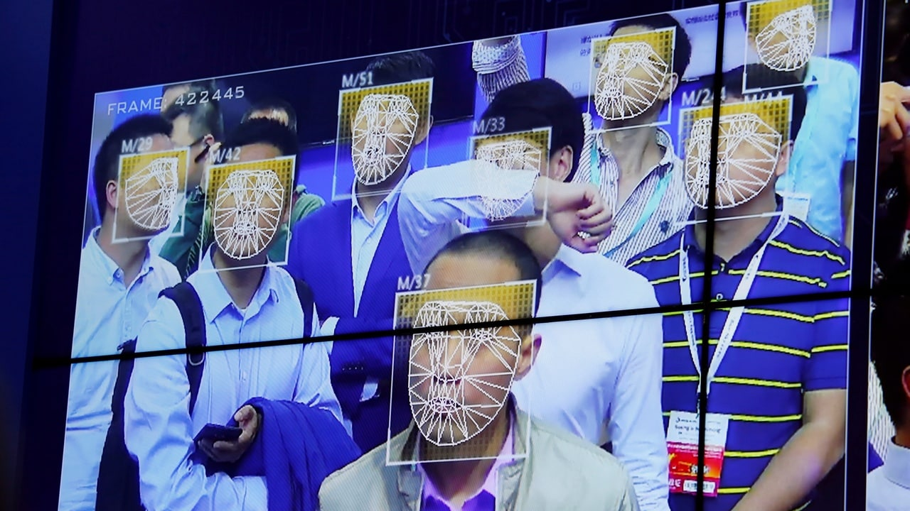 Visitors experience facial recognition technology at Face++ booth during the China Public Security Expo in Shenzhen. Reuters