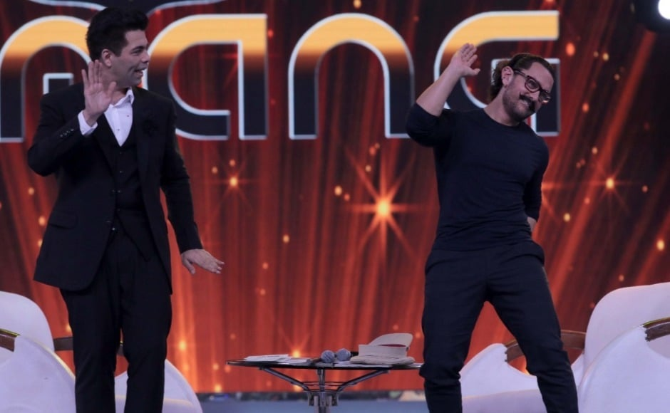 Aamir Khan shows of Karan Johar his moves. Photo: Firstpost/Sachin Gokhale
