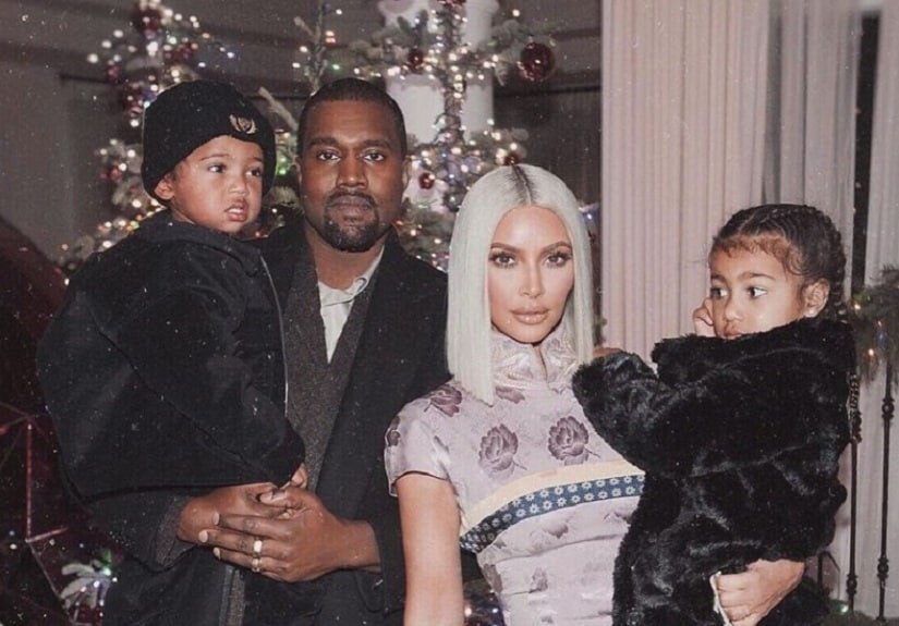 Kayne West and Kim Kardashian with their children