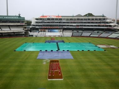The main pitch at the Newlands Stadium is covered as play is delayed due to rain. REUTERS