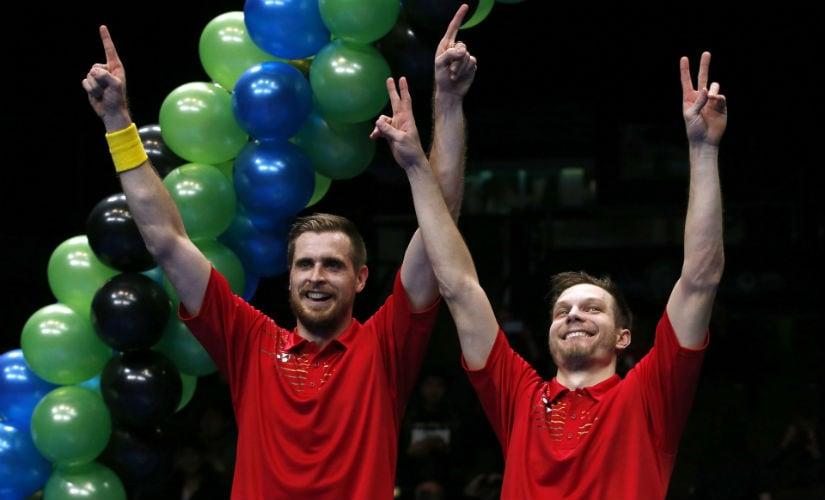 Russia's Vladimir Ivanov and Ivan Sozonov after winning the men's doubles final of the All England Open 2016. Reuters