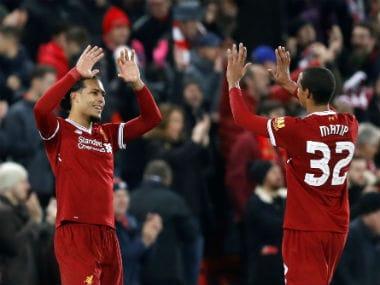 Liverpool's Virgil van Dijk scores on his debut against Everton. Reuters