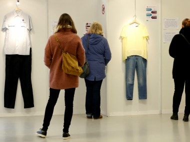 """Visitors are seen at the exhibition """"What Were You Wearing?"""" that showcases the stories of U.S. student rape victims through representations of the outfits they wore during their assault. Reuters"""