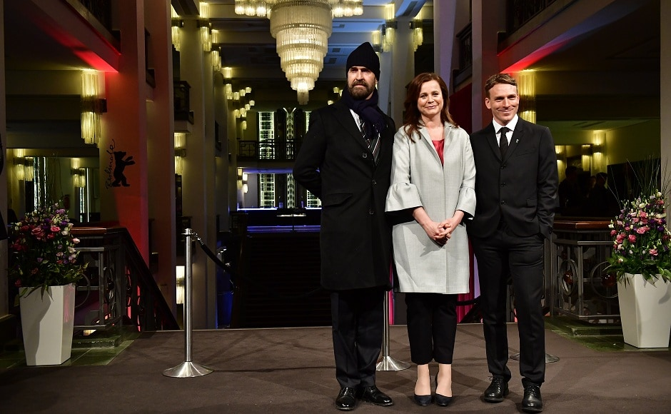 (L-R) British actor and director Rupert Everett, British actress Emily Watson and British actor Edwin Thomas pose on the red carpet for the premiere of The Happy Prince at Friedrichstadtpalast, presented in the section Berlinale Special Gala at the Berlinale film festival on 17 February, 2018 in Berlin. AFP/ Tobias Schwarz