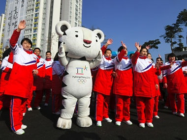North Korean athletes take part in a welcoming ceremony for the team at the Olympic Village in Gangneung on February 8, 2018, ahead of the Pyeongchang 2018 Winter Olympic Games. / AFP PHOTO / JUNG Yeon-Je