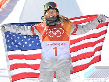 Chloe Kim celebrates during the victory ceremony after winning the women's snowboard halfpipe final. AFP