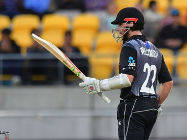 New Zealand's Kane Williamson celebrates his half century during the first Twenty20 cricket match between New Zealand and England at Westpac Stadium in Wellington on February 13, 2018. / AFP PHOTO / Marty MELVILLE