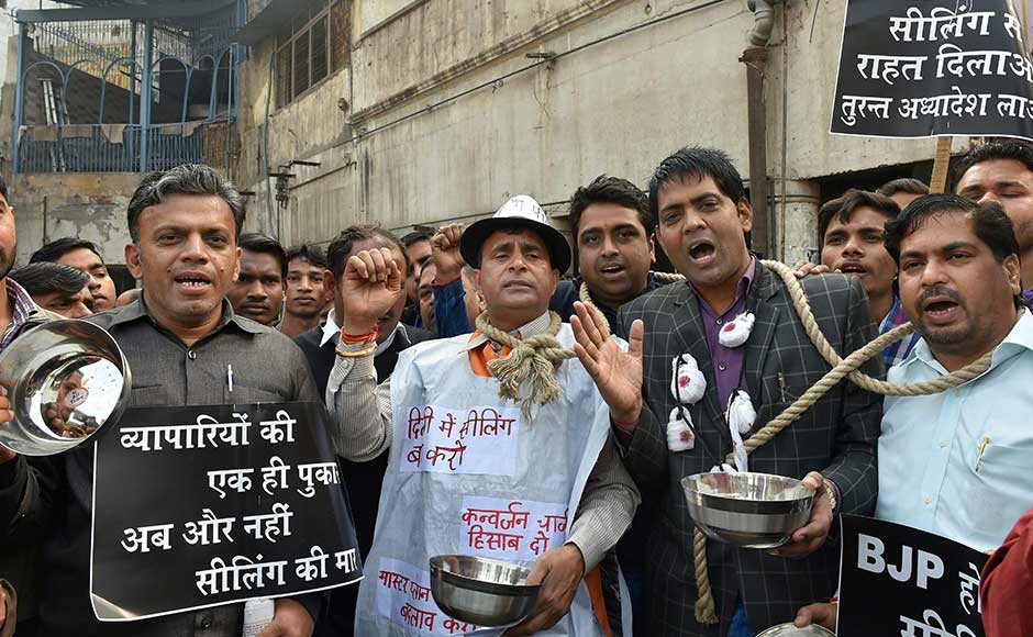 Traders took out a protest march in a number of markets, demanding that the sealing exercise be stopped immediately. Traders raise anti-government slogans at Chandni Chowk. PTI