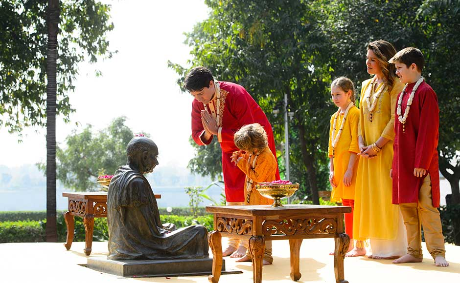 The first engagement of the Trudeau family, dressed in shades of festive yellow and red, was a visit to the Sabarmati Ashram. AP