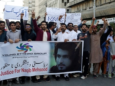 People chant slogans and hold signs as they condemn the death of Naqibullah Mehsud in Karachi. Reuters