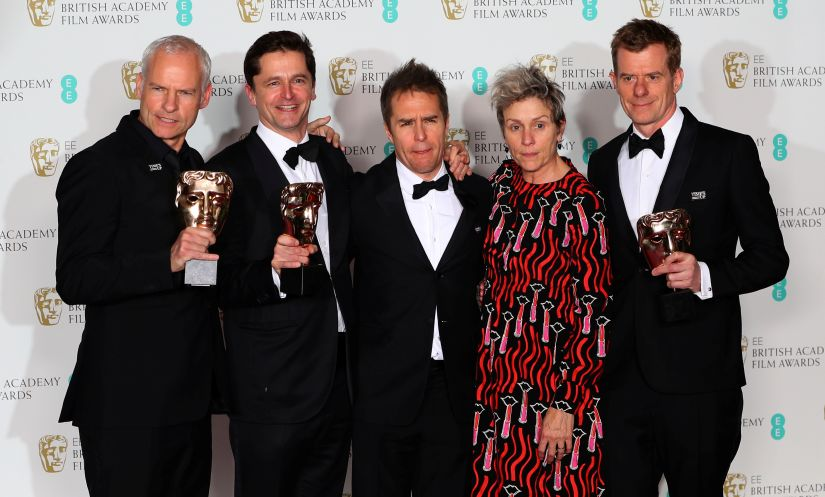 Martin McDonagh, Peter Czernin, Sam Rockwell and Graham Broadbent, pose with Frances McDormand, as they hold their trophies for Best Film for 'Three Billboards Outside Ebbing Missouri' at the British Academy of Film and Television Awards (BAFTA) at the Royal Albert Hall in London, Britain February 18, 2018. REUTERS/Hannah McKay - RC19F125C470