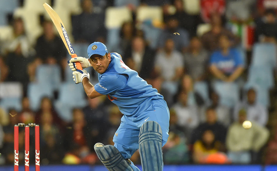 India's MS Dhoni upped the ante for his side and slammed his second T20I fifty off 27 balls. AFP