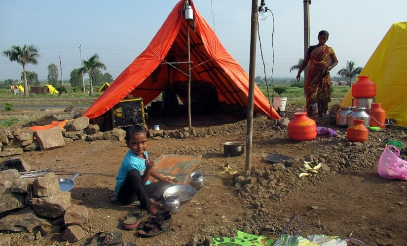 Vishnu Pawar's family have made a makeshift tent just outside Belgaum city, where they work in the merciless cane fields. Image courtesy Parth MN