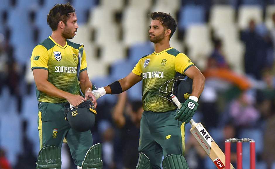 South Africa's Farhaan Behardien and JP Duminy celebrate after winning the second T20I against India by six wickets. AFP