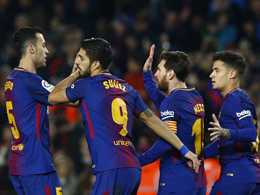 FC Barcelona's Luis Suarez, second left, celebrates after scoring during the Spanish La Liga soccer match between FC Barcelona and Girona at the Camp Nou stadium in Barcelona, Spain, Saturday, Feb. 24, 2018. (AP Photo/Manu Fernandez)