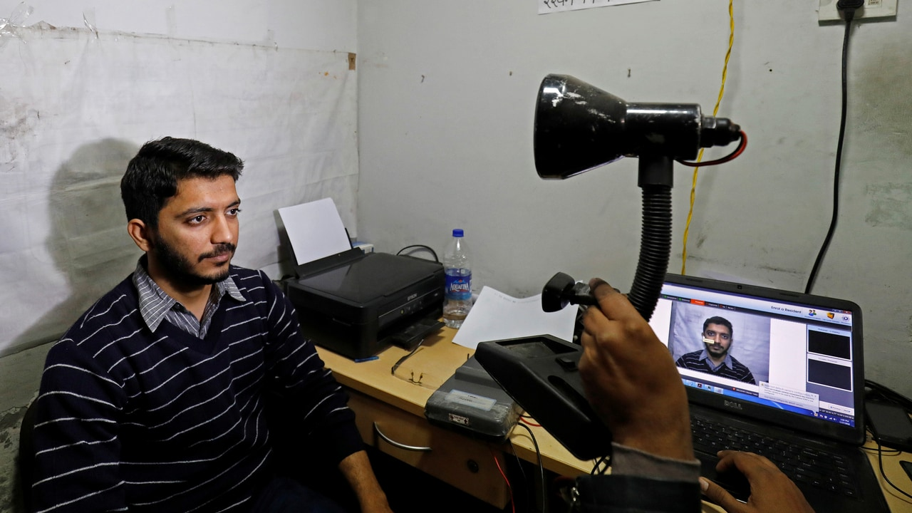 A man goes through the process of eye scanning for the Unique Identification (UID) database system, Aadhaar, at a registration centre. Image: Reuters
