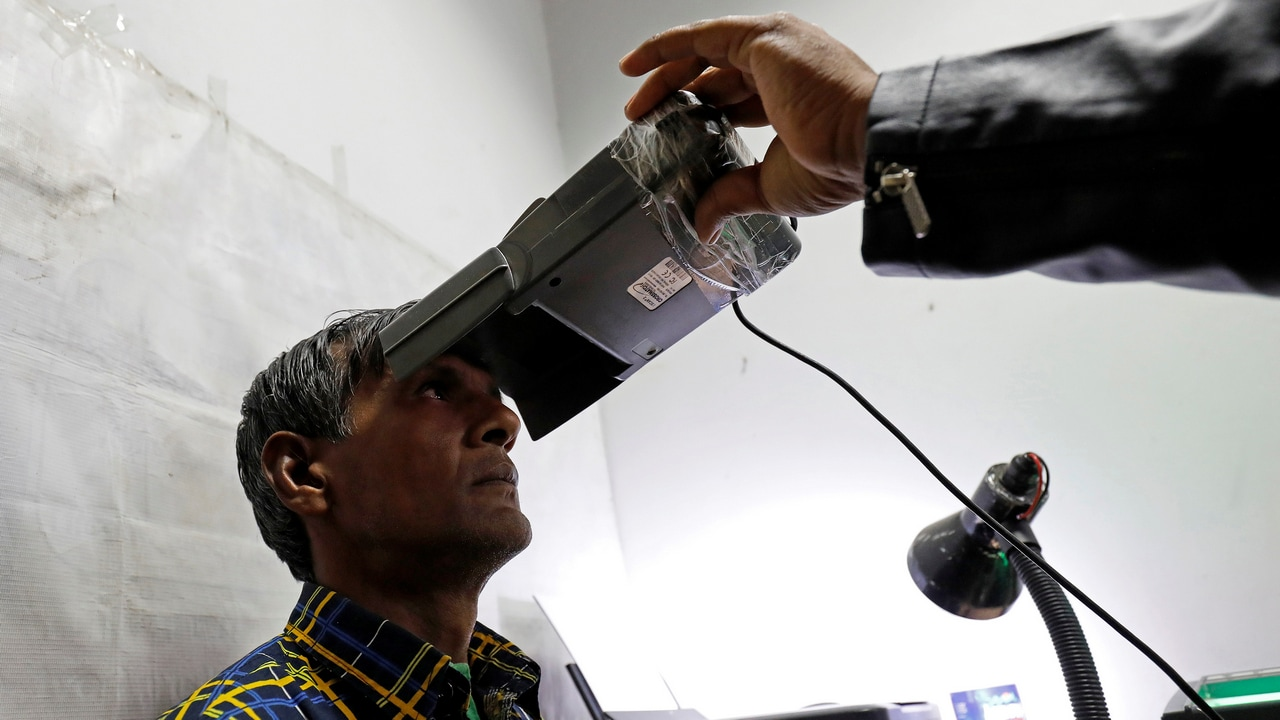 A man goes through the process of eye scanning for the Unique Identification (UID) database system, Aadhaar, at a registration centre in New Delhi, India.  Image: Reuters