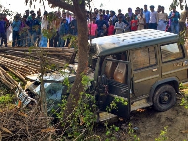 Muzaffarpur: By-passers gather around the vehicle that was involved in a road accident that resulted in the death of at least 9 children in Muzaffarpur on Saturday. At least nine school children died and 14 injured after they were hit by a speeding SUV while trying to cross a road. PTI Photo (PTI2_24_2018_000134B)