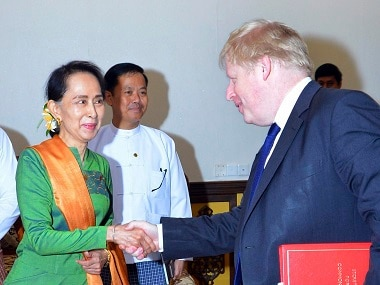 Britain's foreign secretary Boris Johnson, is welcomed by Myanmar's Aung San Suu Kyi. AP