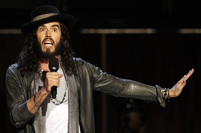 "Actor and comedian Russell Brand speaks during the taping of the Spike TV special tribute ""Eddie Murphy: One Night Only"" at the Saban theatre in Beverly Hills, California November 3, 2012. The program airs November 14. REUTERS/Mario Anzuoni (UNITED STATES - Tags: ENTERTAINMENT) - GM1E8B419SL01"
