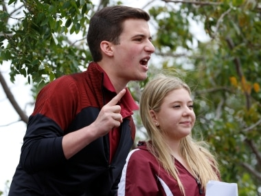 Marjory Stoneman Douglas High School student leaders Cameron Kasky and Jaclyn Corin speak to the crowd prior to boarding buses travelling to Tallahassee, Florida to meet with legislators, in Coral Springs, Florida, U.S. February 20, 2018. REUTERS/Joe Skipper - RC18BF4C5330