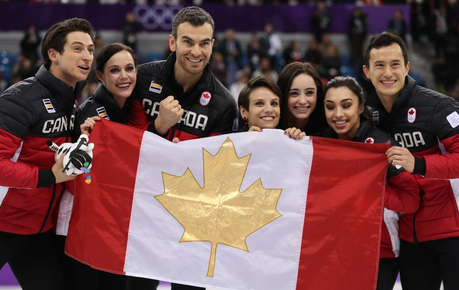 Canada's team celebrate after winning gold in the Team Event Ice Dance Free Dance competition of figure skating. Reuters