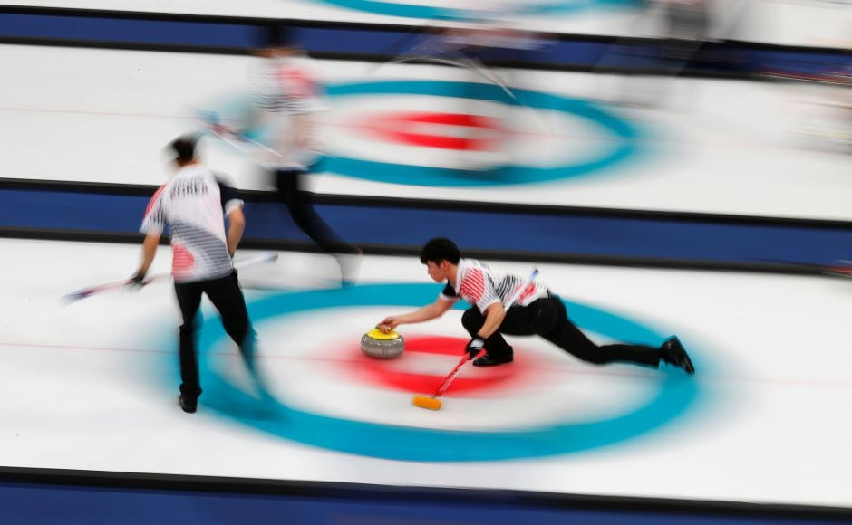 South Korea deliver a stone during the men's round robin against South Korea. Reuters
