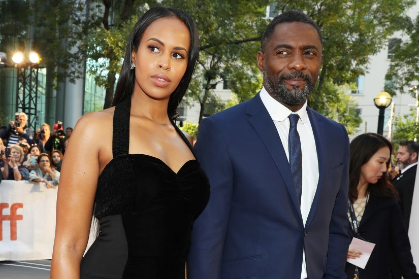 "Actor Idris Elba arrives with his girlfriend Sabrina Dhowre at the premiere of the film ""The Mountain Between Us"" at Toronto International Film Festival (TIFF) in Toronto Canada, September 10, 2017. REUTERS/Fred Thornhill - RC185E137080"
