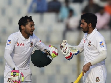 Mominul Haque (R) talks to his teammate Mushfiqur Rahim (L) during the first day of the first Test between Bangladesh and Sri Lanka. AFP