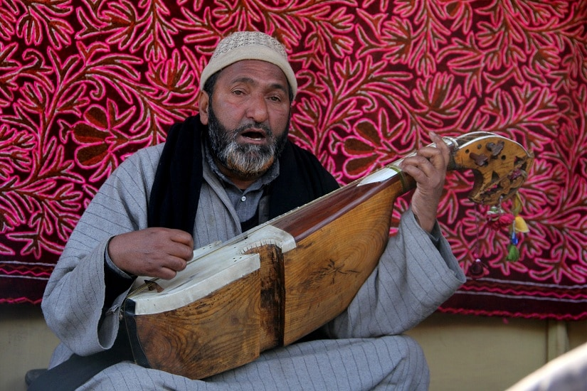 Noor Mohammad, a local artist plays the rabab. Photograph by Sameer Mushtaq