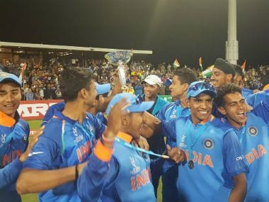 Caption: The victorious Indian team with the winner's trophy after defeating Australia in the final. Image credit: Twitter/@cricketworldcup