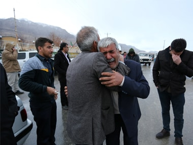 Relatives of passengers who were believed to have been killed in a plane crash react near the town of Semirom, Iran. Reuters