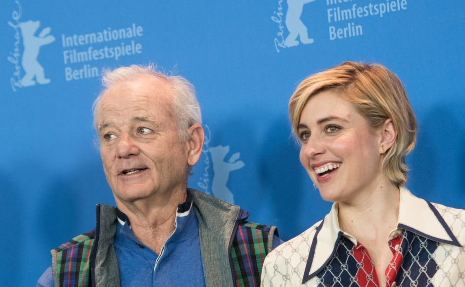 Actor Bill Murray and Lady Bird director Greta Gerwig pose during a photocall upon arrival for a press conference to present the animated feature Isle of Dogs at the Berlinale film festival. AFP/StefanieLoos
