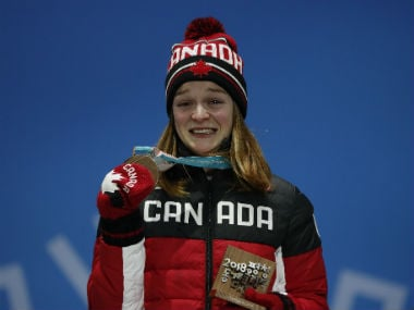 Bronze medallst Kim Boutin of Canada reacts on the podium. Reuters