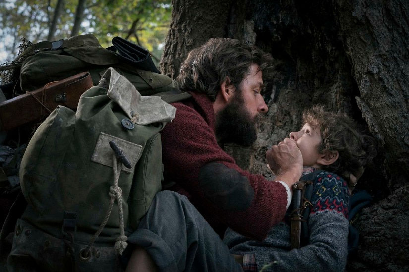 John Krasinski and Millicent Simmonds in A Quiet Place. AP