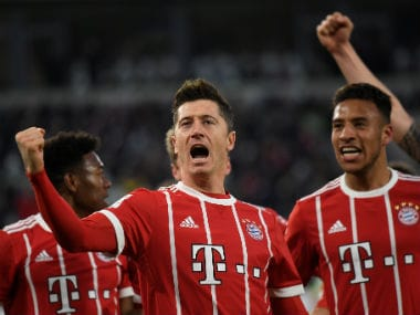 Bayern Munich's Robert Lewandowski celebrates scoring their second goal with teammates. Reuters