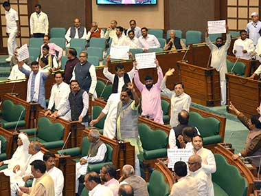Congress MLA's disrupt the speech of Madhya Pradesh Governor Anandiben Patel demanding justice for farmers on the first day of the budget session of the State Assembly. PTI